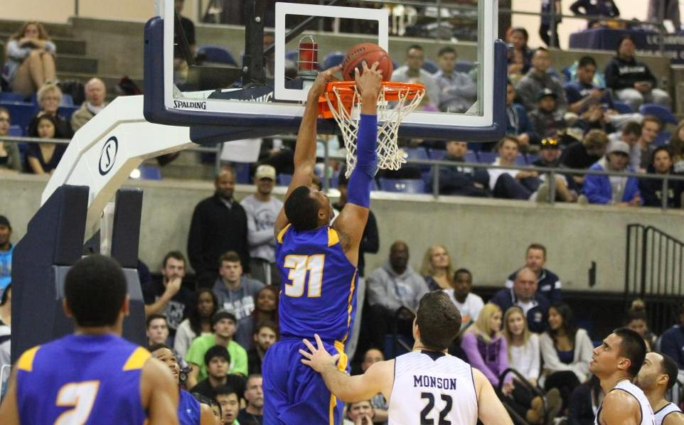 John Green dunks during UCSB's 70-64 loss at UC Davis Thursday. (Photo by Gerry Fall)