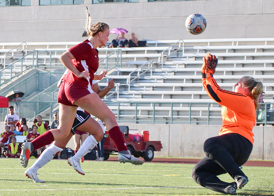 Katy Coats heads in the game-tying goal as PCC women's soccer played to a 2-2 draw v. Palomar Tuesday afternoon, photo by Richard Quinton.