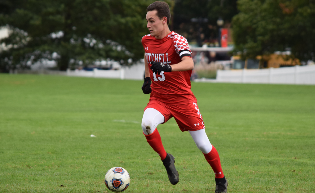 Men's Soccer Secures NECC Bye with Win at Lesley