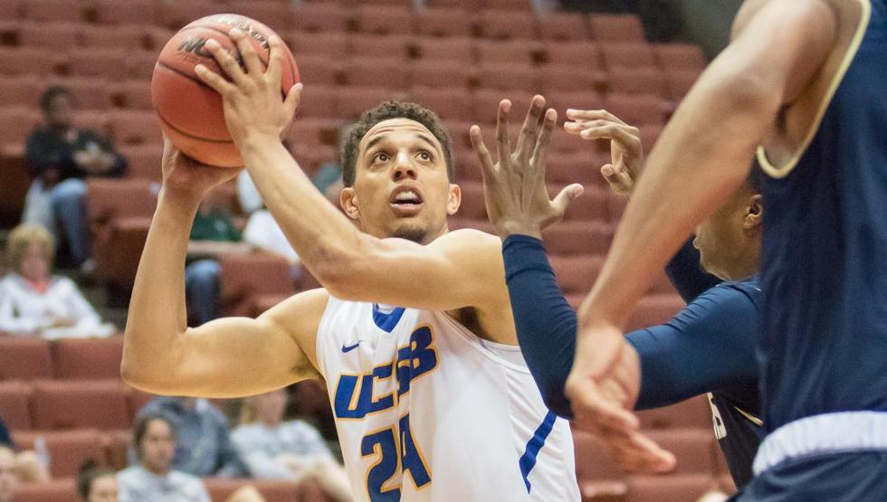 Michael Bryson goes up for two of his 24 points as UCSB blasted UC Davis in a quarterfinal game at the Big West Tournament on Thursday, 87-61. (Photo by Rudy Huezo)