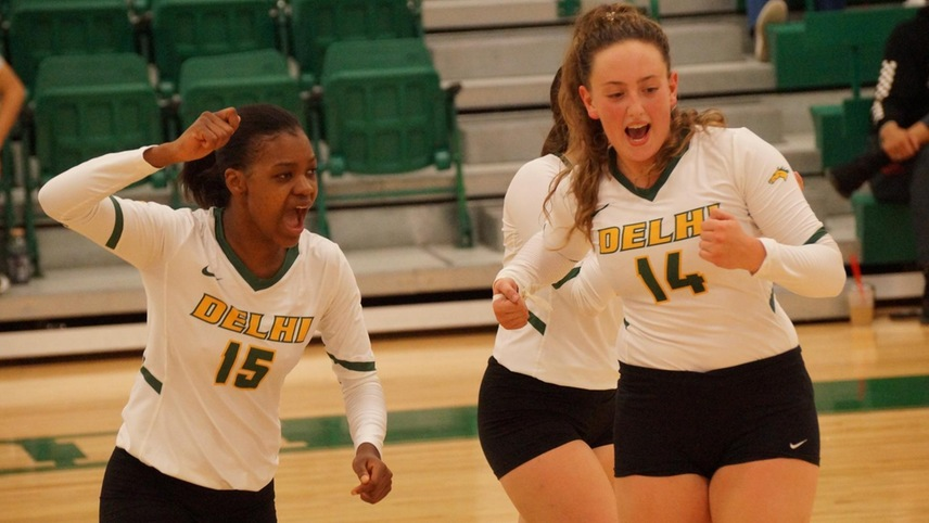 Witchney Clersainville and Taylor Tsatsis celebrating after a point.