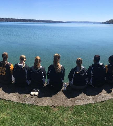 Softball team looking out at lake