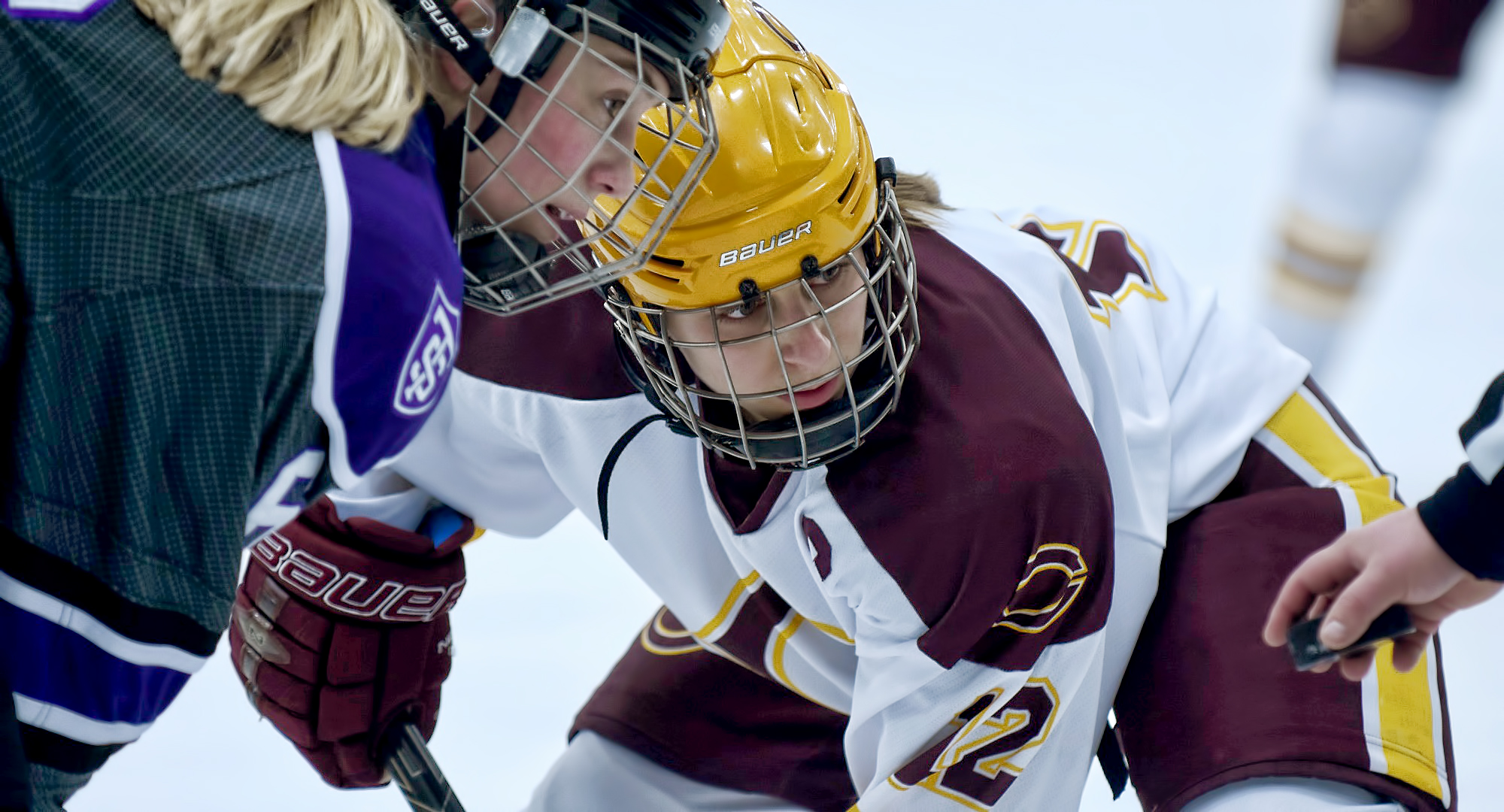 Senior Megan Dondelinger eyes the puck before a faceoff. She scored the only goal of the game in the Cobbers' 1-1 OT tie with #2 St. Thomas.