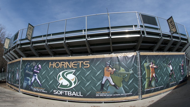 SOFTBALL UNVEILS BANNER DEPICTING SOME OF THE PROGRAM'S ALL-TIME GREATS