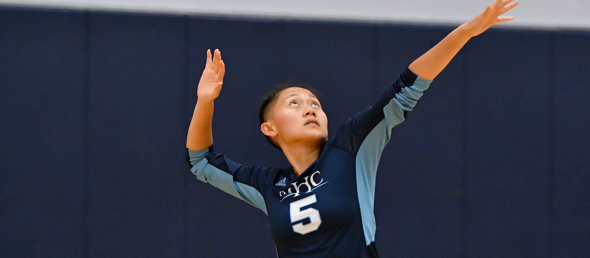 Action photo of Lyons volleyball player, Loriya Thao.