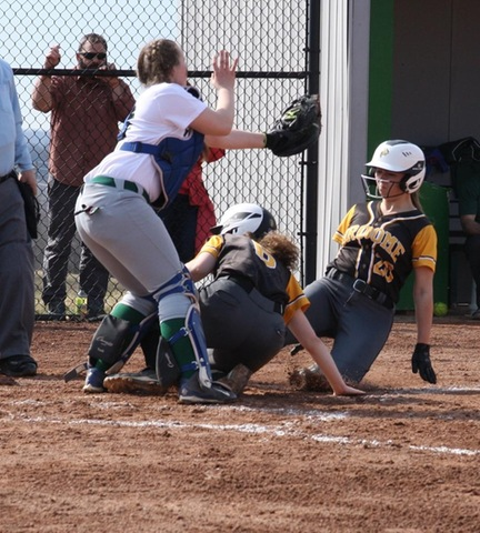 Two Broome players at sliding into home plate under tag