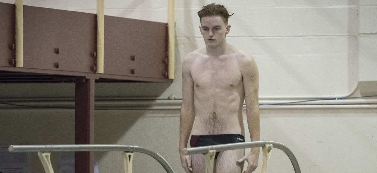 Pennington Finishes Runner Up on the One-Meter Board; Men's Swimming and Diving Opens Competition at NEWMAC Championships