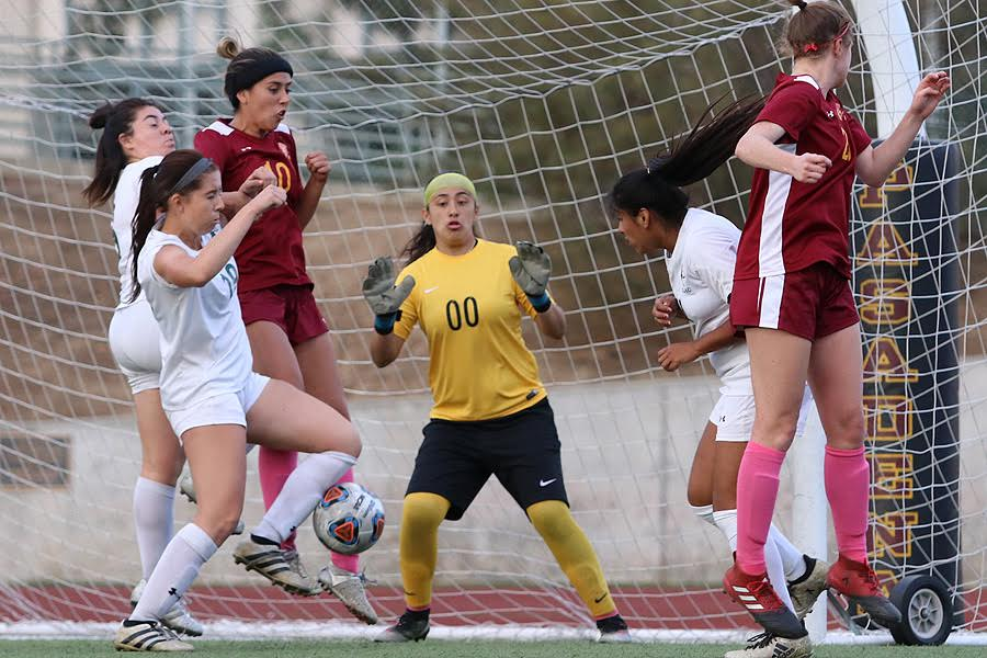 Alexxis Molinar (far left) gets control of this throw-in and then scored the tying goal in PCC's 1-1 deadlock v. East Los Angeles Tuesday at Robinson Stadium, photo by Richard Quinton.