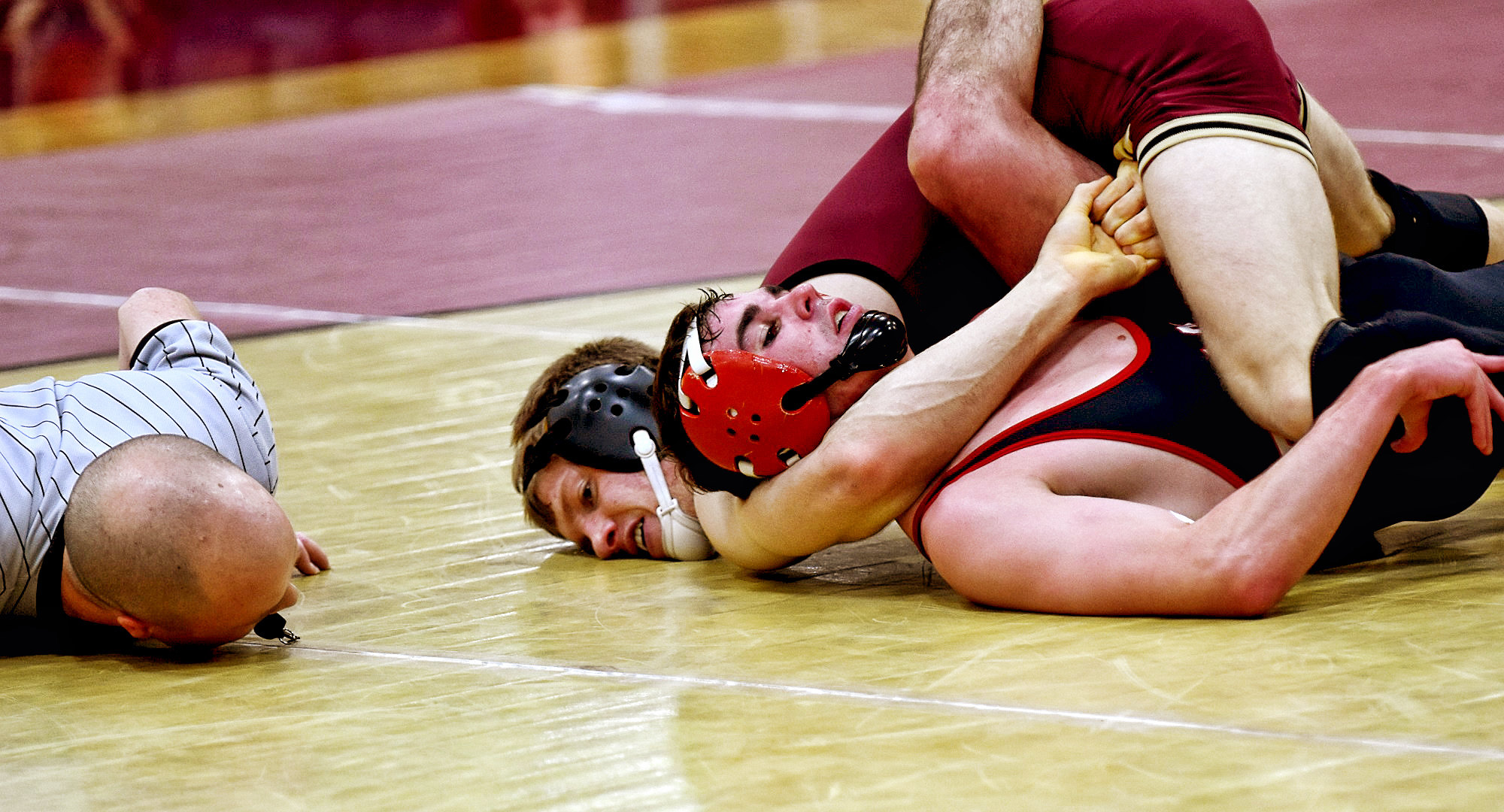 Sophomore Ben Bogart gets his opponent's shoulders on the mat just before the referee taps out to give him the pin during the Cobbers' dual with MSU Moorhead.