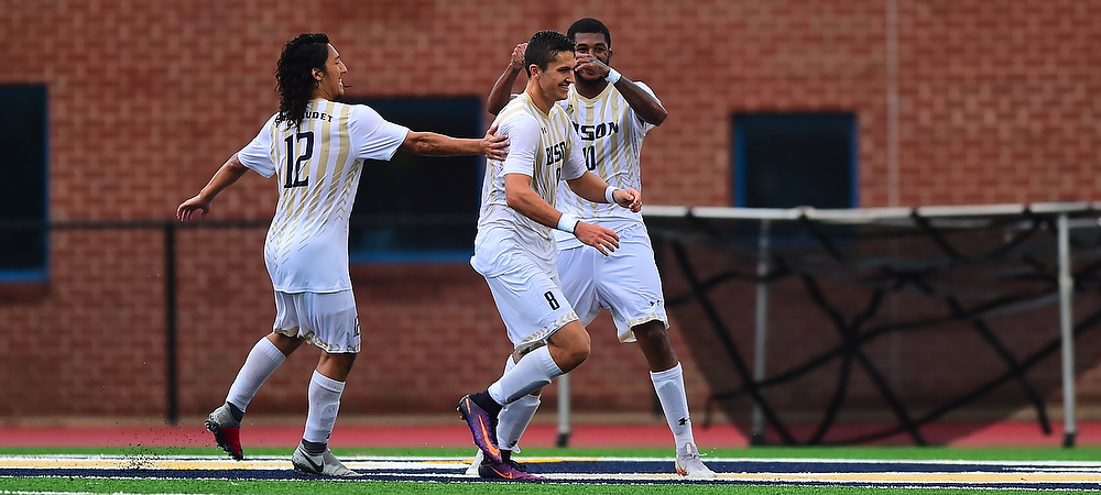 Gallaudet's Sean O'Callaghan celebrates with his teammates after a goal