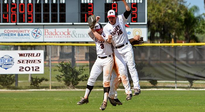 Outfielders Kyle Jackson, Luke Parker, and Andrew Stroud celebrate after the final out as the Eagles beat the Manatees 17-3. (Photo by Tom Hagerty, Polk State.)