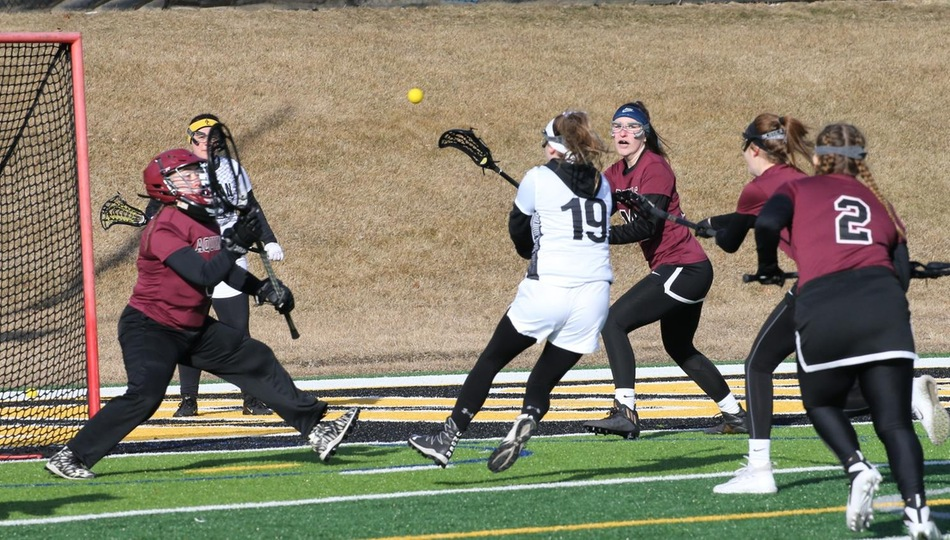 Sophomore Gwyneth Carlson (19) scored the game winning goal 37 seconds into overtime in Adrian's 14-13 comeback victory over Augustana on Sunday (Photo by Mike Dickie).