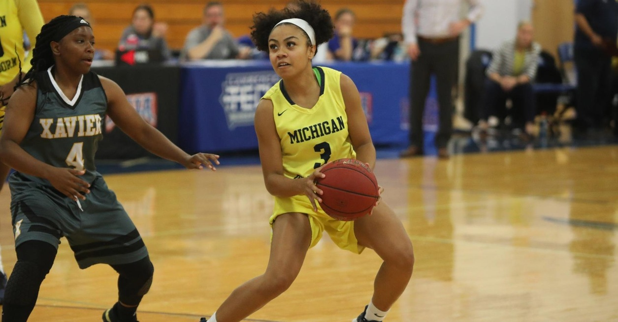 Wolverines pull away late for 84-68 win