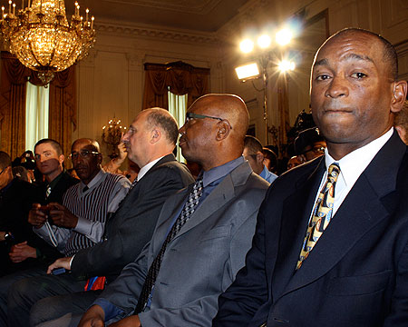 Coach Curtis Pride and his coaching staff in the East Room.