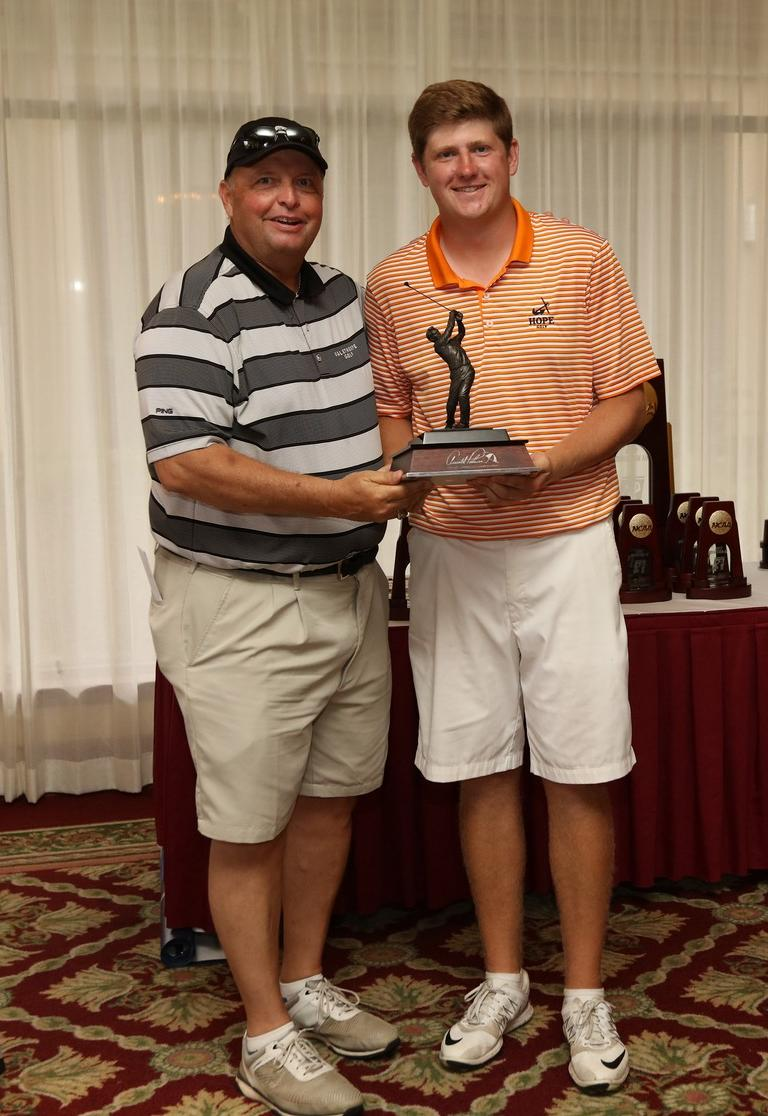 Josh Gibson holds the Arnold Palmer trophy given to the individual national champion in men's golf