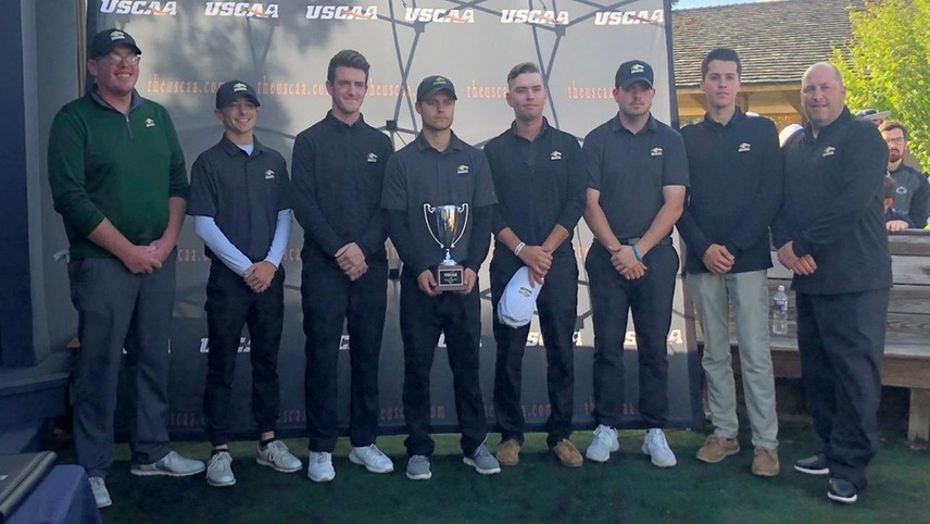 The men's golf team posing with their second place USCAA Championship trophy.