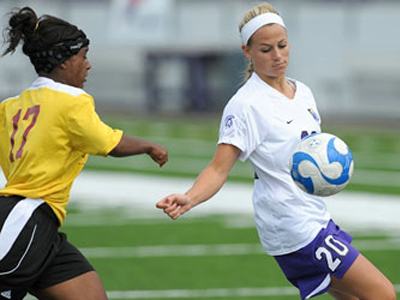 Mekyla Spraggins (#17) vies for the ball with Winona State's Lauren Sturdivant in Sunday's action.  (Photo courtesy of Winona State University Athletics)