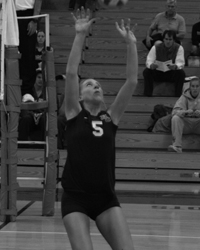 Black and white action photo of Meghan Hall playing volleyball