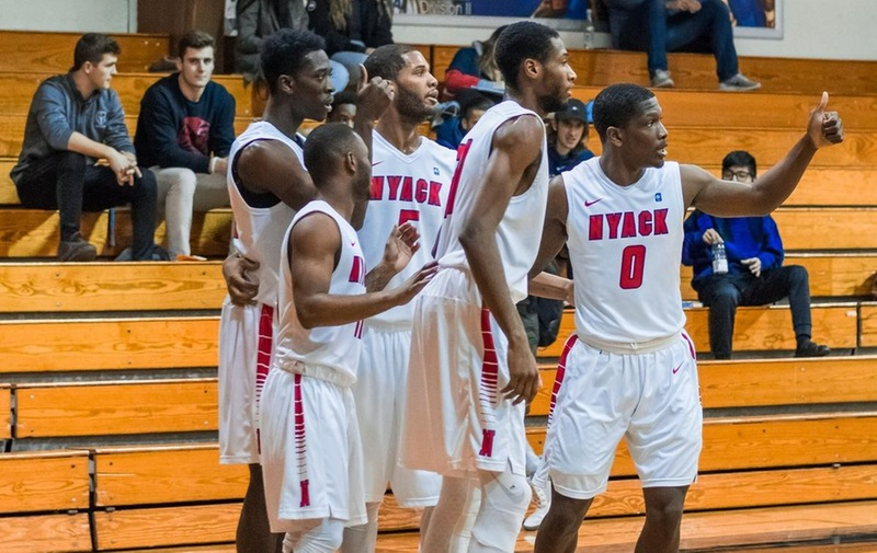 Men's Basketball Pushes Past Holy Family Tigers