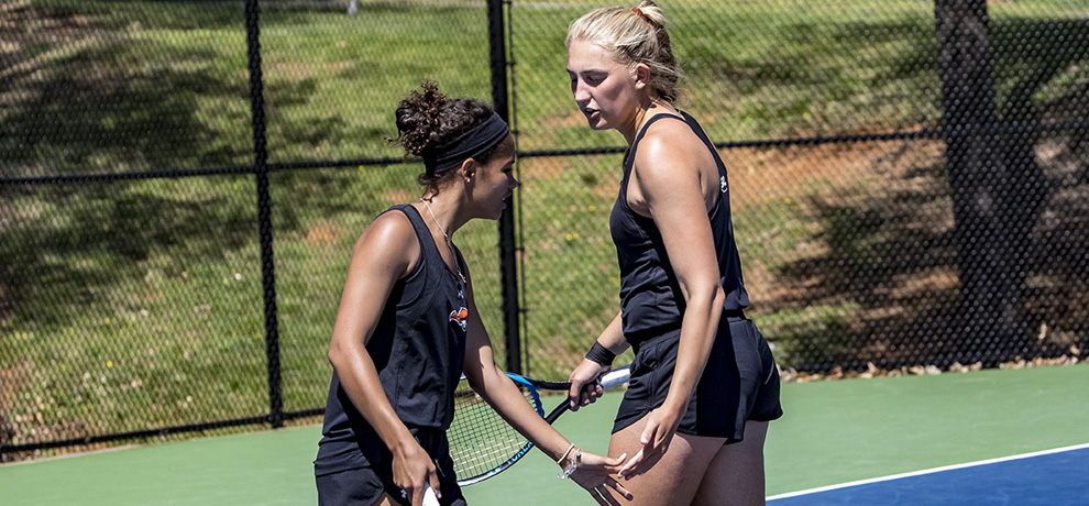 Brittani Brooks (left) and Emilie Hansen rallied from 2-5 down to win their doubles match (photo by Chuck Williams)
