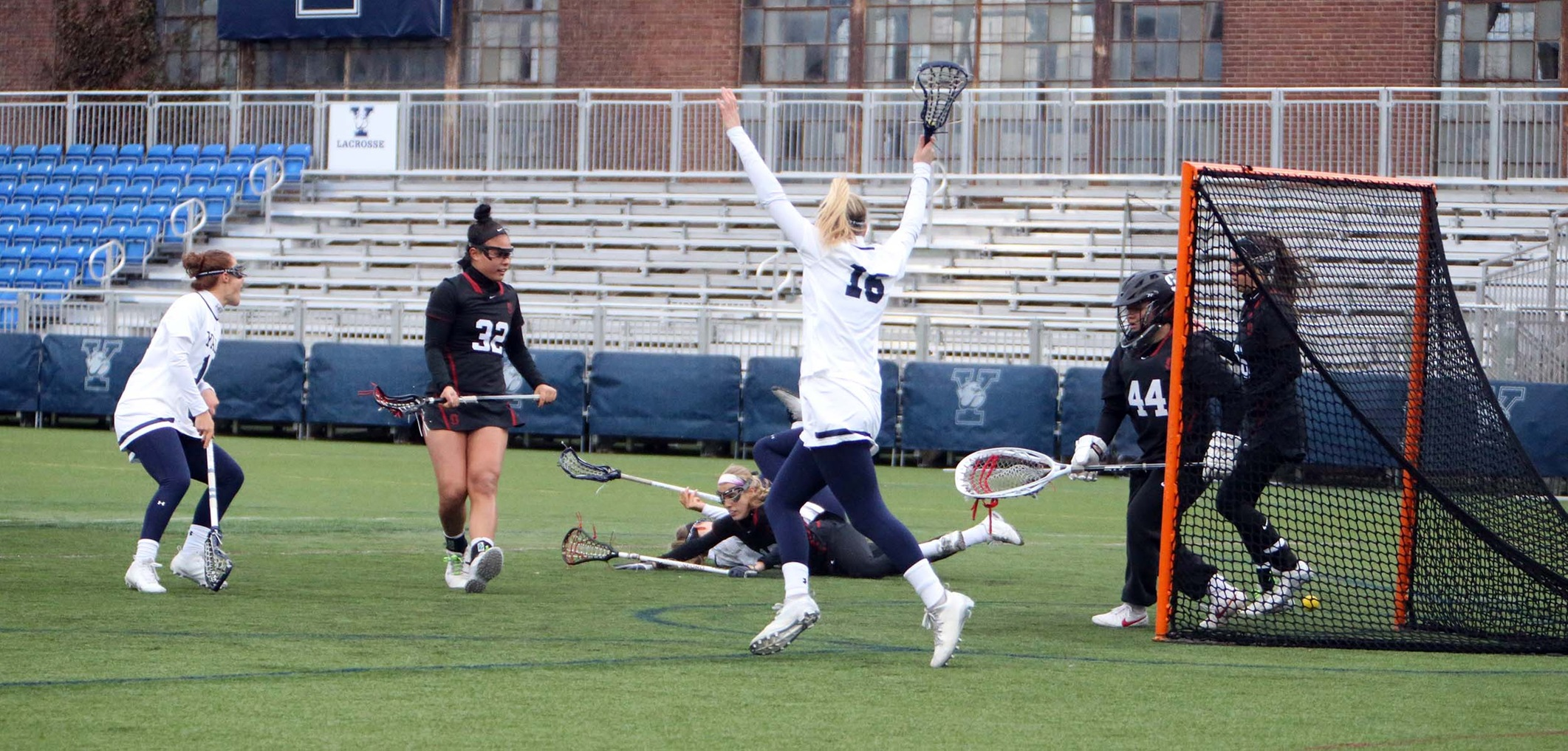 Yale celebrates a goal by Izzy Nixon. (photo by Sam Rubin '95, Yale Sports Publicity)