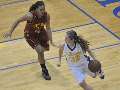 Ferris' Tiara Adams plays defense on LSSU's Nicole Marshall (Photo by Rob Bentley)
