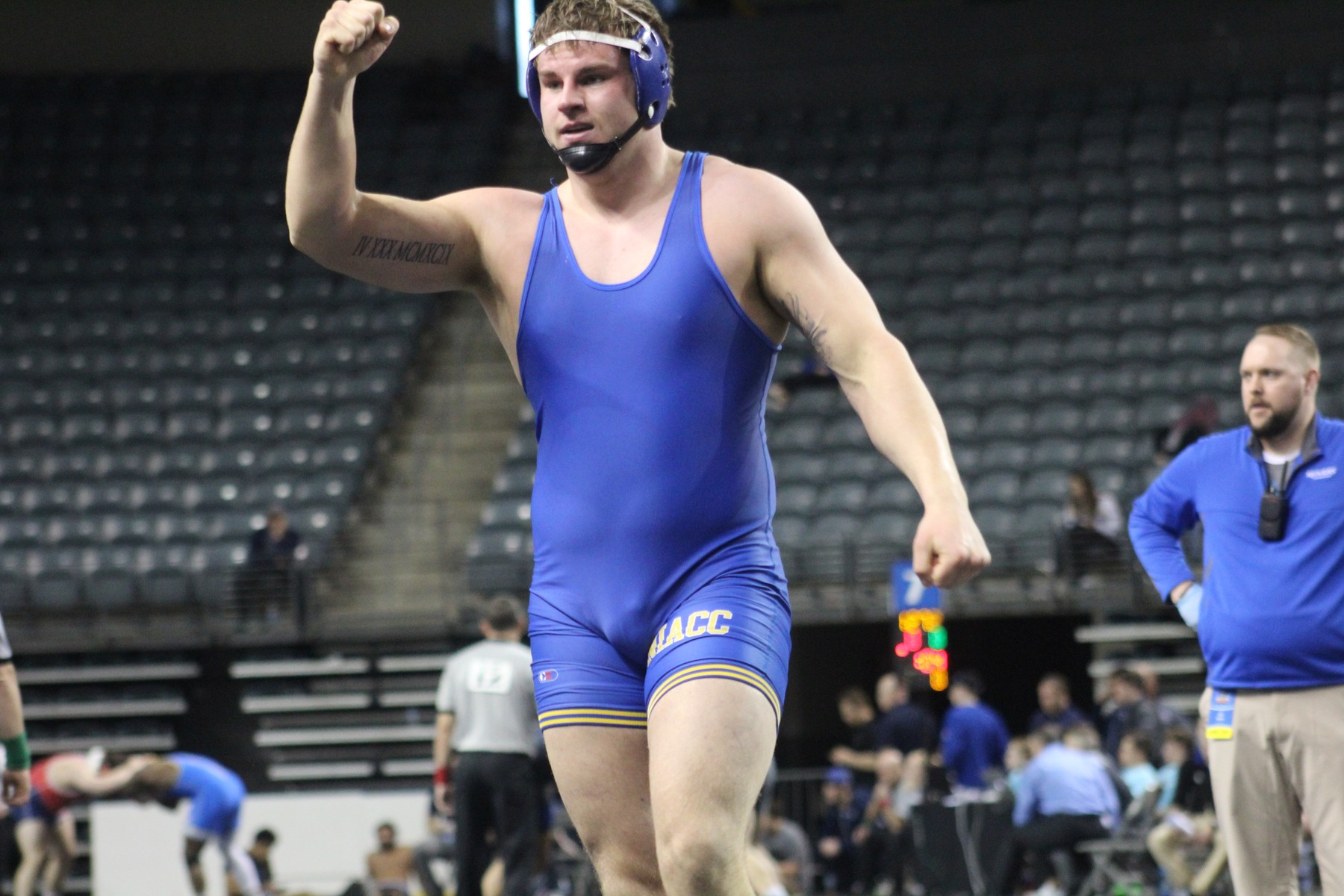 NIACC's Zach Santee celebrates his second-round pin at 285 pounds at the national wrestling tournament in Council Bluffs.