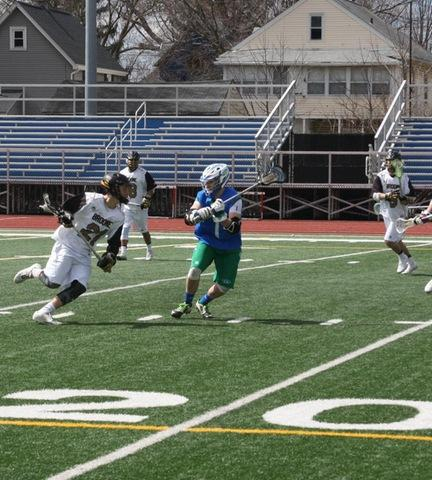 SUNY Broome men's lacrosse player looking to score on opponent