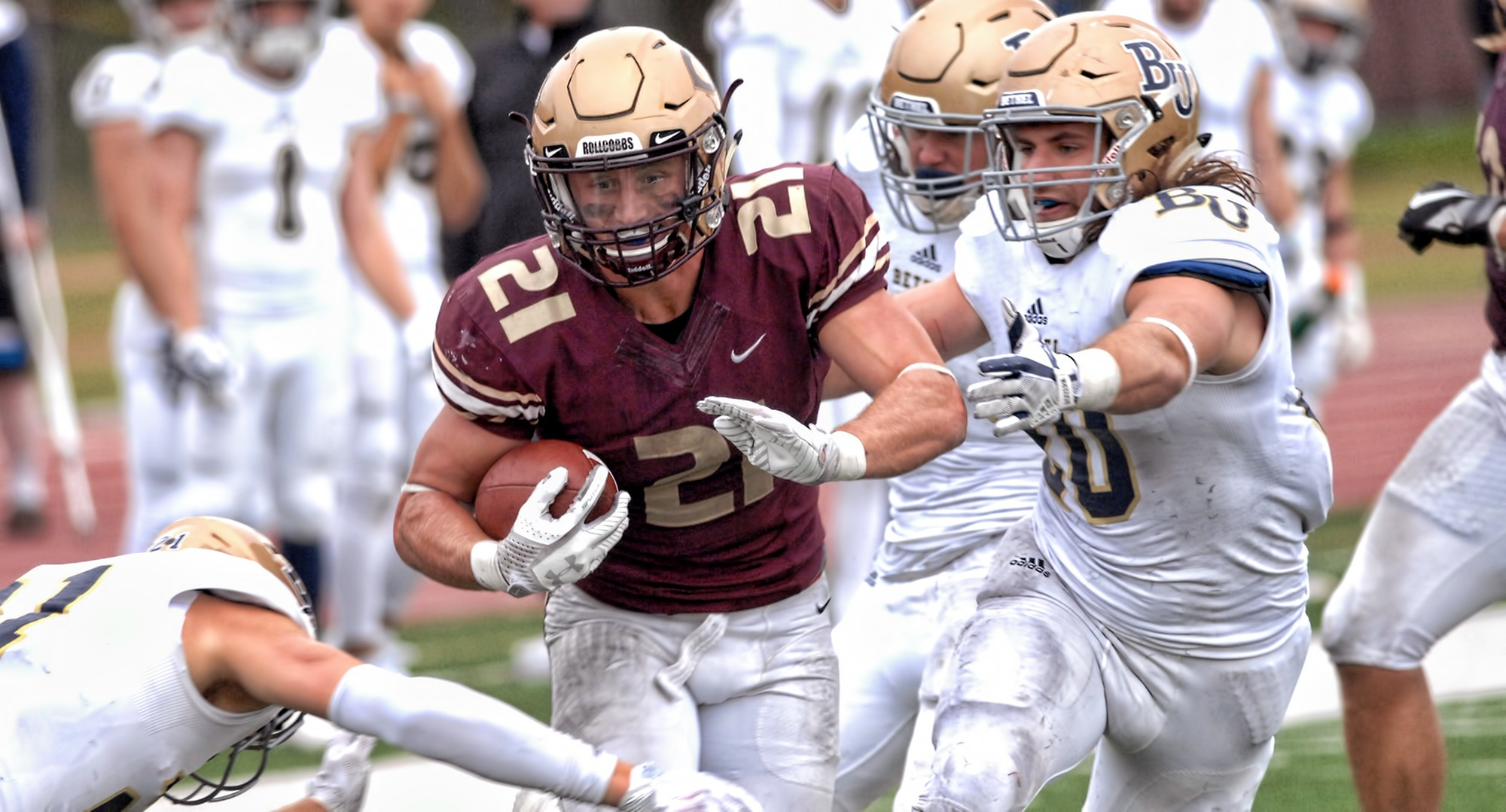 Chad Johnson breaks through three Bethel tacklers on his way to rushing for 191 yards in the MIAC-opening win for the Cobbers.