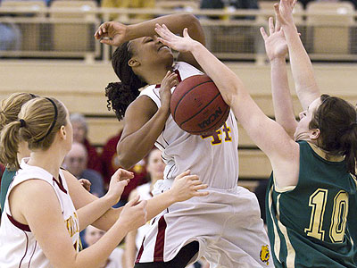 Ferris senior Tiara Adams battles in Thursday's conference opener (Photo by Ben Amato)
