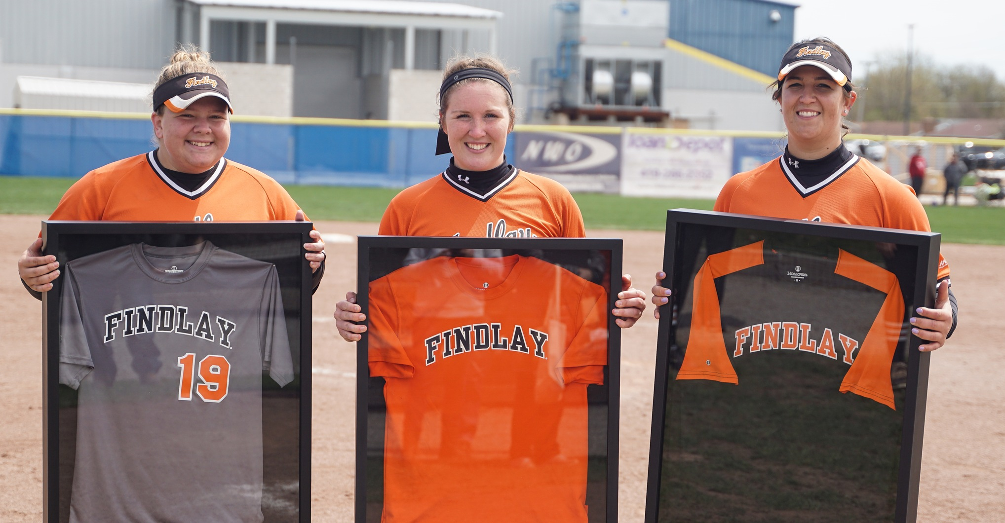 Salwa Al-Hajabed, Hailey Bryan, and Amanda DelMonte pose with their jerseys on Senior Day