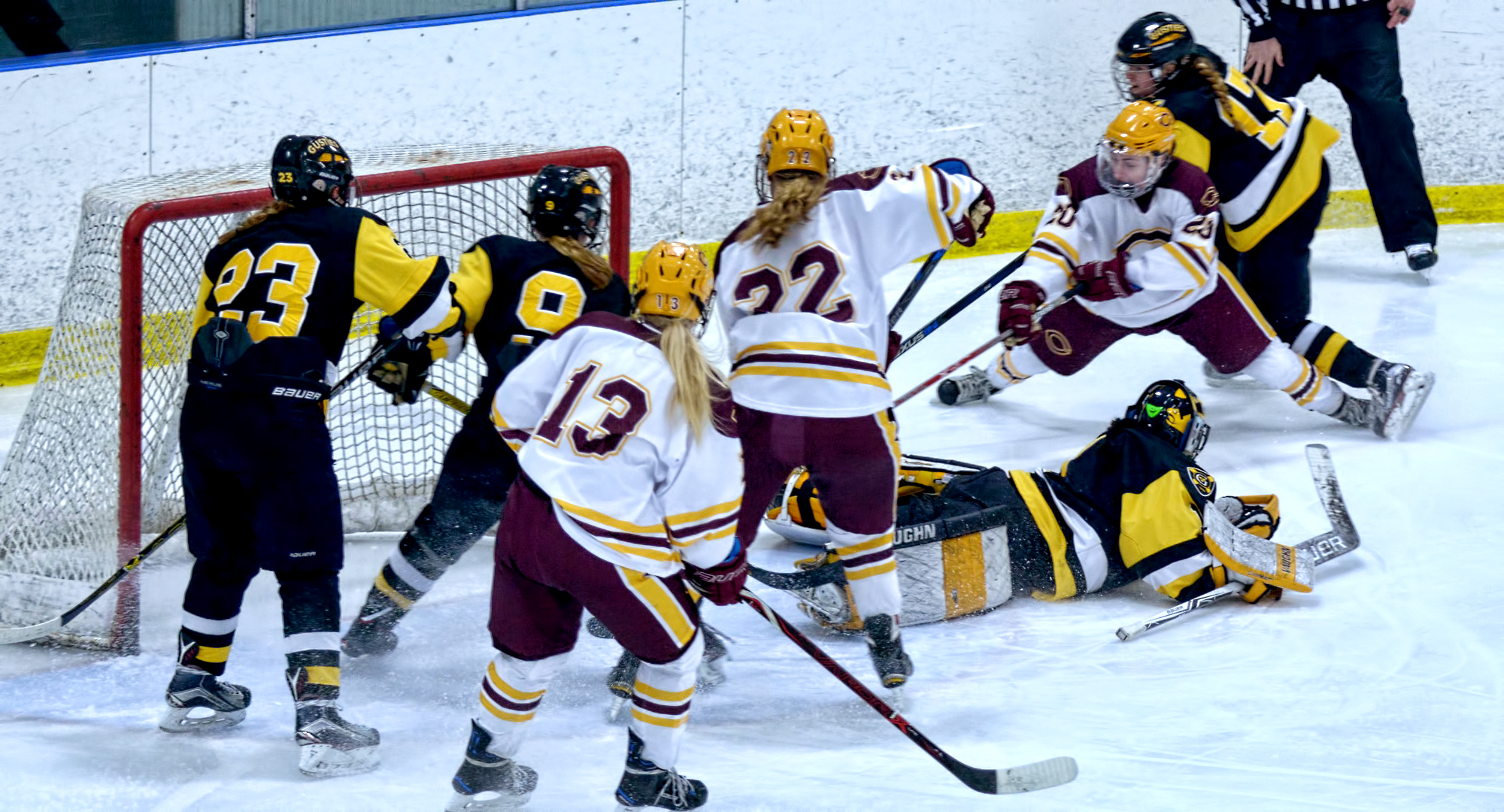 Maiah McCowan (#20) is forced around the Gustavus net before setting up the Cobbers' lone goal against the Gusties.