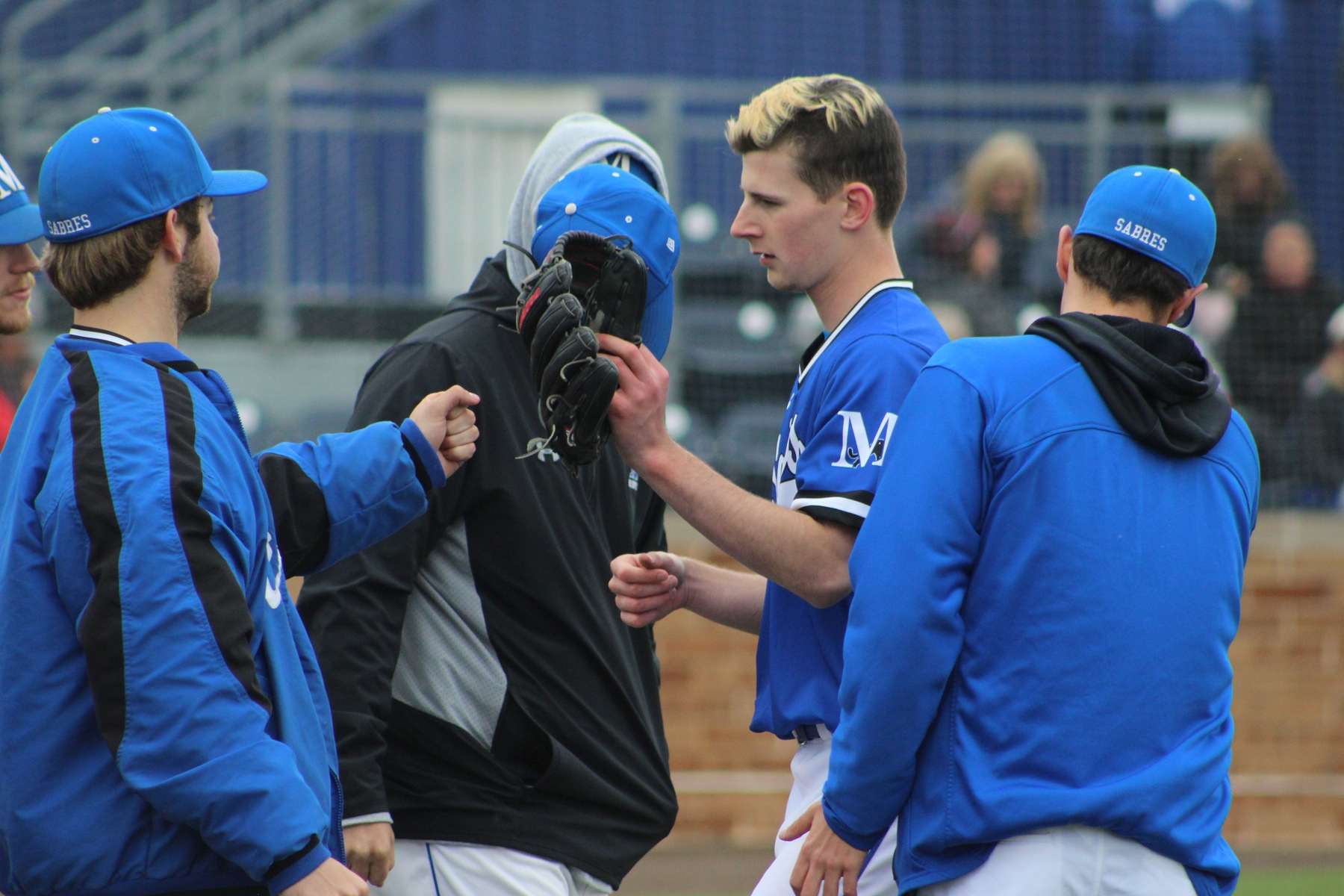 Ty Peccioli is greeted by teammates as he heads to the dugout.
