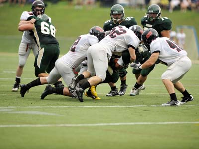 CUA overcomes fourth quarter deficit to down McDaniel 39-36