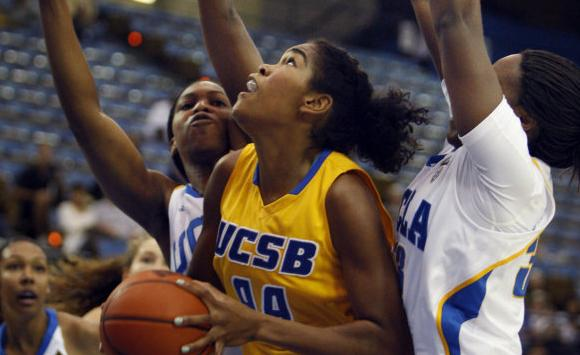 UC Santa Barbara's Meika Valentine, front center, is pressured by UCLA's Christina Nzekwe, front left, and Thea Lemberger, right, in the first half of an NCAA college basketball game in Los Angeles on Sunday, Nov. 14, 2010. (AP Photo/Christine Cotter)