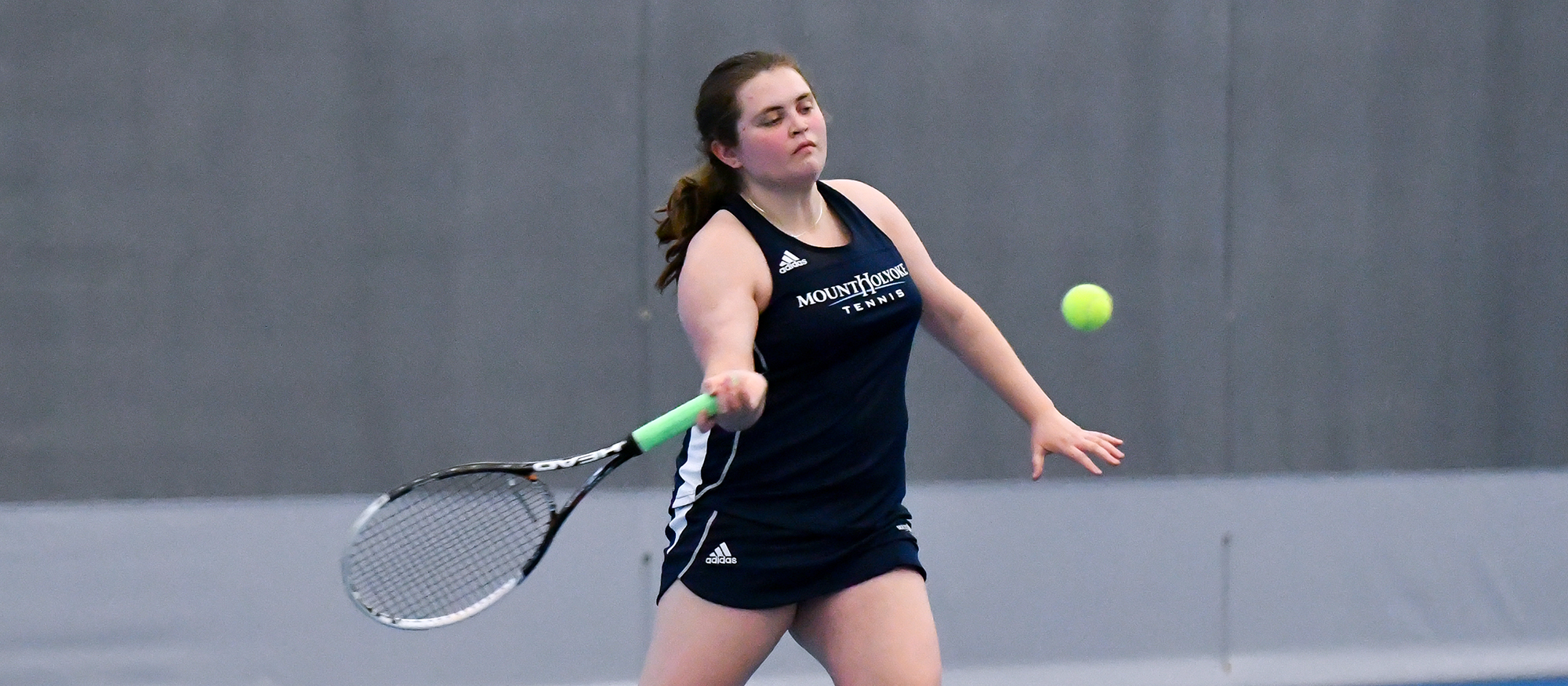 Action photo of Lyons tennis player, Madison Rosen.
