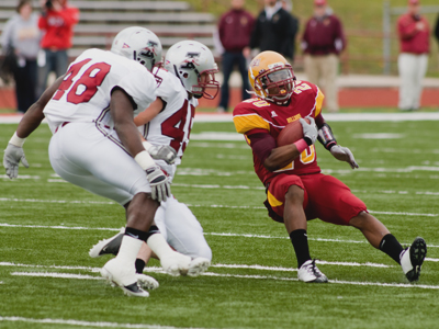 Ferris' David Freeman tries to stay on his feet against Indianapolis (Photo by Ed Hyde)