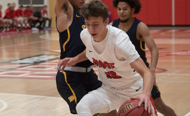Men's Basketball Shoots Past Marian in Second Half