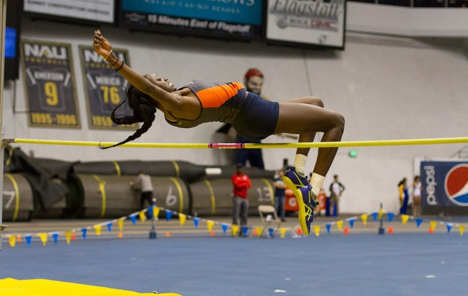 Iesha Hamm sailing over the high jump  bar