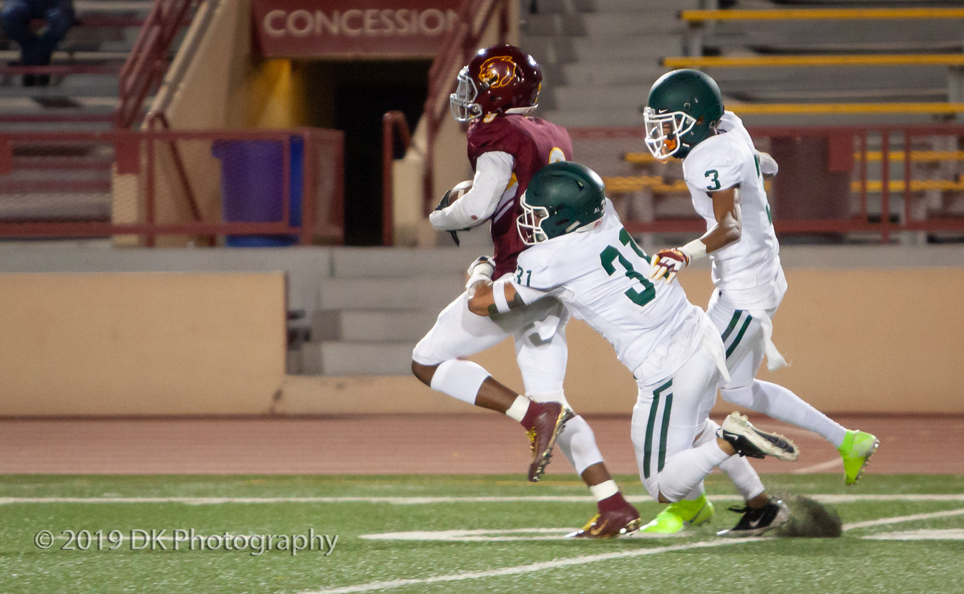 City College wide receiver Robert Harrison (#3) makes the catch and gets pulled down just short of the end zone against Diablo Valley at Hughes Stadium on Sept. 21st.