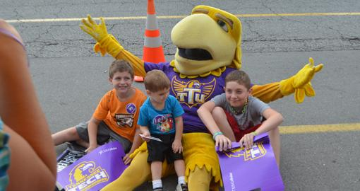 Won't you be my neighbor? Purple Pride Caravan highlighted by peculiar twist