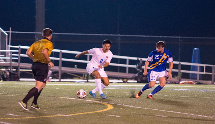 Wu's PK Lifts Lions Over Bobcats