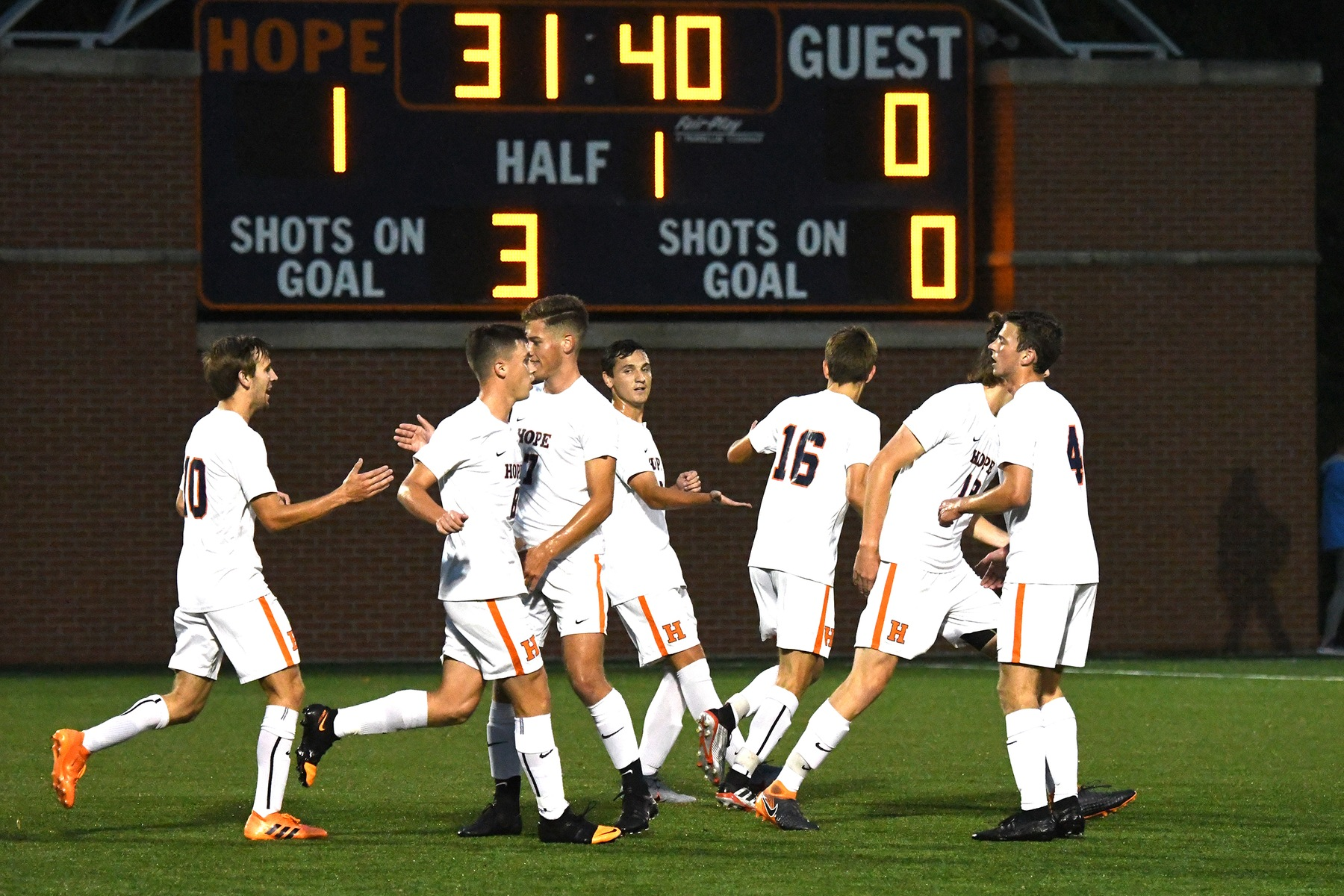 Hope soccer players celebrate a goal