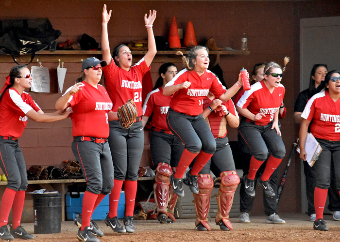 The Huntingdon softball team celebrates after freshman Samara Miller's two-run single put the Lady Hawks ahead 3-1 in the sixth inning of Game 2 in Saturday's doubleheader with Salem. (Photo by Wesley Lyle)
