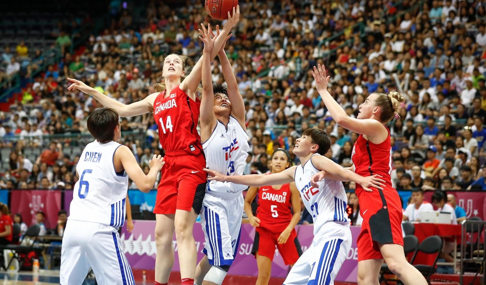 Mathieu Belanger / Alex Kiss-Rusk (McGill University) fights for the ball during women's basketball action against Chinese Taipei on Friday. Canada lost their quarter-final 74-67 to the hosts and will now play 5-8th place games.