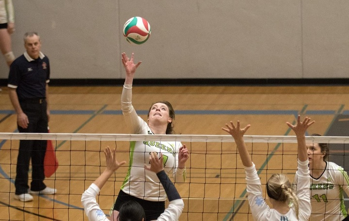 Megan Schmidt (14) contributed 7 kills and 3 stuff blocks in the bronze medal victory. Photo - Tony Hansen