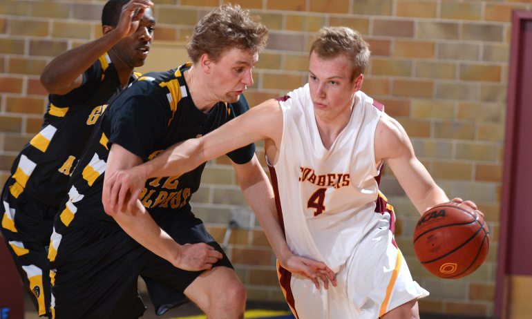 Tom Fraase dribble the ball up court in the Cobbers' wn over Gustavus. Fraase had a season-high 17 points vs. the Gusties.