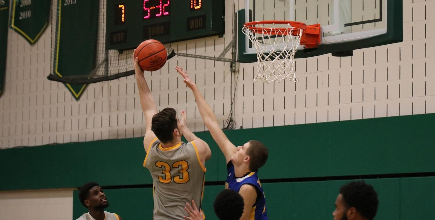 Ryder Mansfield (33) recorded his 11th double-double against Penn College on Sunday -- Photo by Brooke Overton (1/9/19)