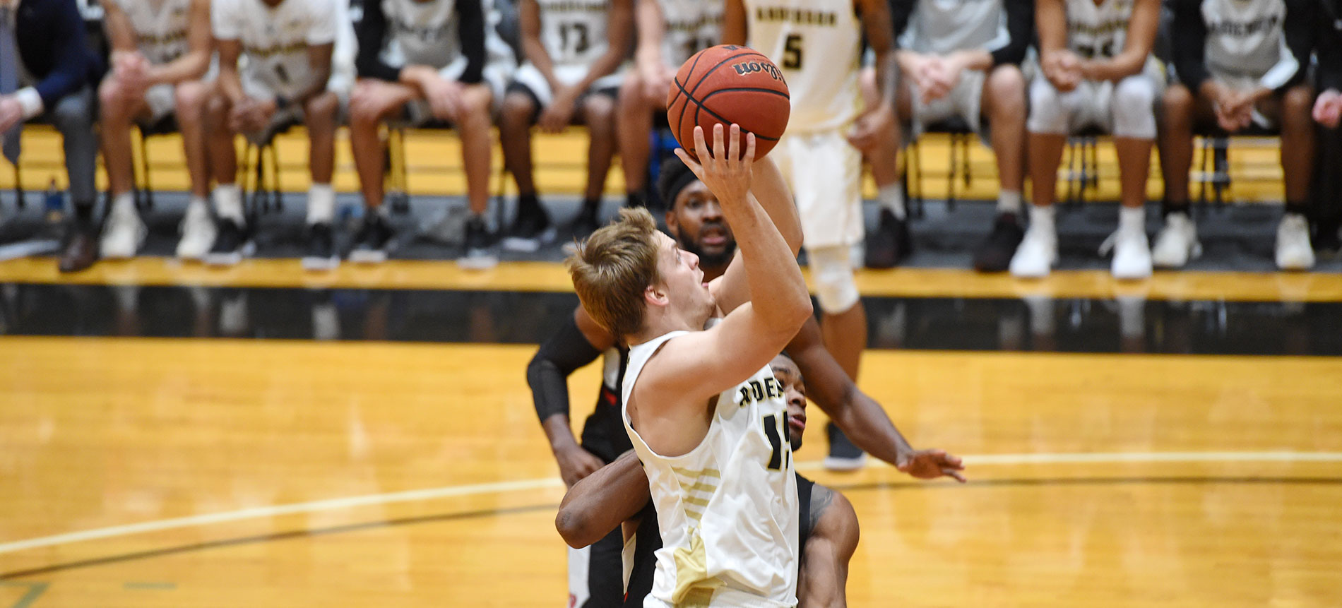 Coker Uses Pair of Second-Half Runs to Hand Trojans Second Straight Loss