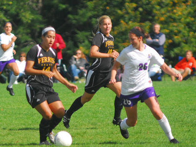 Logan DeClercq (#14) and Bri Borgman (#10) battle a Winona State player for ball possession in Sunday's action.